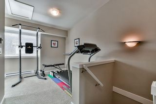 "Photo 15: 211 2110 ROWLAND Street in Port Coquitlam: Central Pt Coquitlam Townhouse for sale in ""AVIVA ON THE PARK"" : MLS®# R2094344"