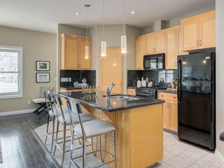Photo 12: 81 Somme Boulevard SW in Calgary: Garrison Woods Residential for sale : MLS®# A1072185
