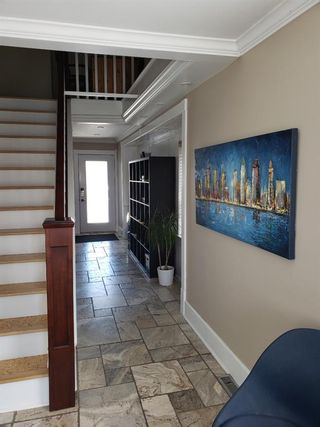 Photo 4: 408 22 Avenue NE in Calgary: Winston Heights/Mountview Detached for sale : MLS®# A1094173
