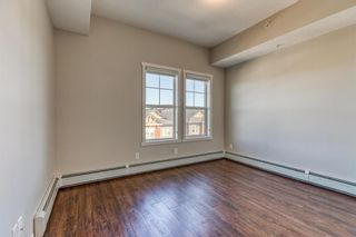 Photo 13: 9308 101 Sunset Drive: Cochrane Apartment for sale : MLS®# A1079009