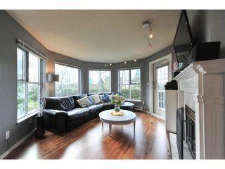 "Photo 1: 106 15130 108TH Avenue in Surrey: Guildford Condo for sale in ""Riverpointe"" (North Surrey)  : MLS®# F1437329"