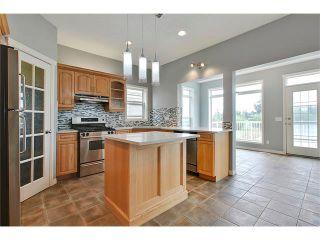 Photo 11: 19 HIDDEN CREEK Green NW in Calgary: Hidden Valley House for sale : MLS®# C4047943