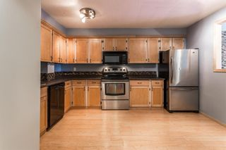 Photo 4: 7 50 8 Avenue SE: High River Row/Townhouse for sale : MLS®# A1146781