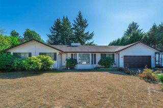 Photo 1: 20492 40 Avenue in Langley: Brookswood Langley House for sale : MLS®# R2557324