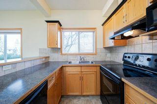 Photo 7: 101 72 Quigley Drive: Cochrane Apartment for sale : MLS®# A1091486