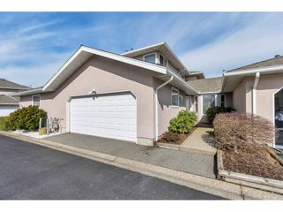 """Photo 1: 113 15501 89A Avenue in Surrey: Fleetwood Tynehead Townhouse for sale in """"AVONDALE"""" : MLS®# R2546021"""