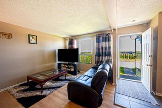 Photo 2: 1202 544 Blackthorn Road NE in Calgary: Thorncliffe Row/Townhouse for sale : MLS®# A1125846