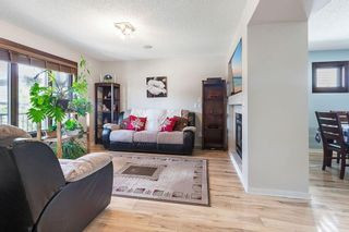 Photo 4: 22 BRIDLECREST Garden SW in Calgary: Bridlewood Detached for sale : MLS®# C4306282