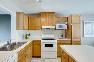 Photo 11: 105 Rocky Ridge Court NW in Calgary: Rocky Ridge Row/Townhouse for sale : MLS®# A1069587