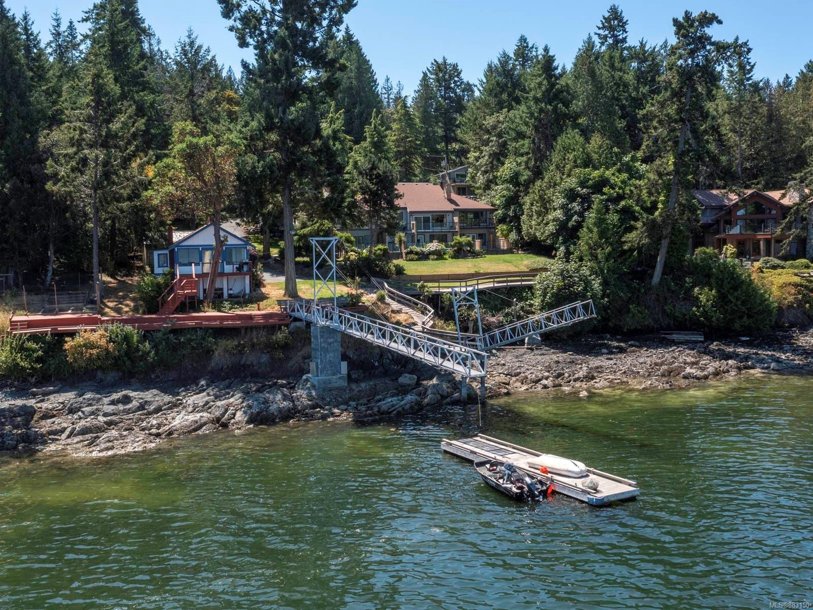 Main Photo: 1032/1034 Lands End Rd in North Saanich: NS Lands End House for sale : MLS®# 883150