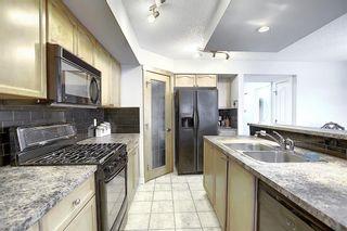 Photo 5: 193 Saddlebrook Way NE in Calgary: Saddle Ridge Detached for sale : MLS®# A1070319
