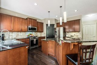 Photo 8: 157 Springbluff Boulevard SW in Calgary: Springbank Hill Detached for sale : MLS®# A1129724