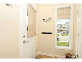 Photo 3: 118 FIRESIDE Bend: Cochrane House for sale : MLS®# C4066576