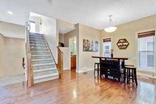 Photo 4: 8029 Cougar Ridge Avenue SW in Calgary: Cougar Ridge Detached for sale : MLS®# A1071162