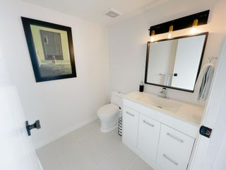 """Photo 12: 405 CARDIFF Way in Port Moody: College Park PM Townhouse for sale in """"EASTHILL"""" : MLS®# R2598640"""