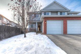 Photo 1: 294 Cranston Drive SE in Calgary: Cranston Semi Detached for sale : MLS®# A1064637