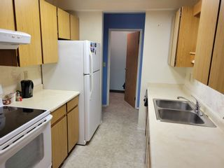 """Photo 2: 212 9672 134 Street in Surrey: Whalley Condo for sale in """"parkwoods"""" (North Surrey)  : MLS®# R2600119"""