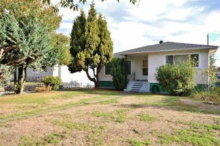 Photo 1: 1592 E 58TH Avenue in Vancouver: Fraserview VE House for sale (Vancouver East)  : MLS®# V1142641
