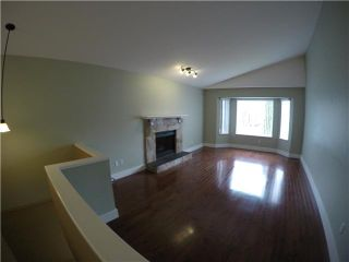 Photo 2: 1386 SUTHERLAND AV in Port Coquitlam: Oxford Heights House for sale : MLS®# V1104543