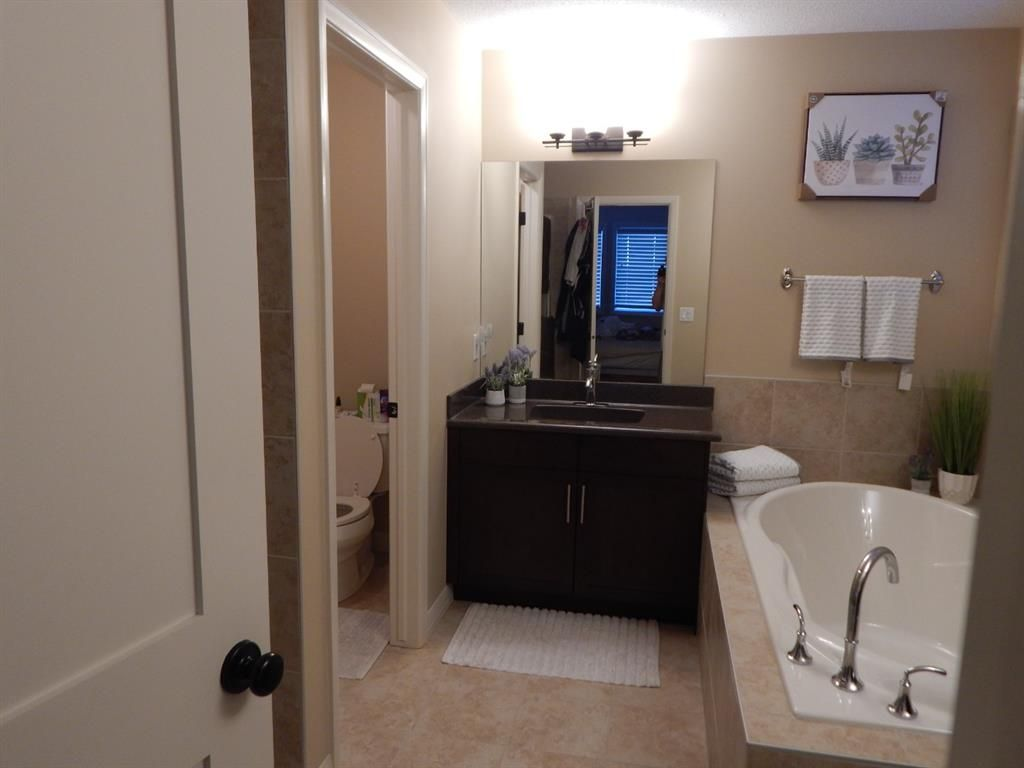 Photo 31: Photos: 215 Panatella View in Calgary: Panorama Hills Detached for sale : MLS®# A1046159
