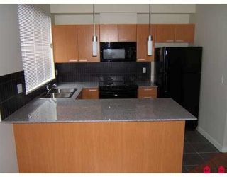 """Photo 4: 110 10455 UNIVERSITY Drive in Surrey: Whalley Condo for sale in """"D'Cor"""" (North Surrey)  : MLS®# R2236174"""