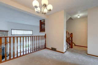 Photo 4: 100 23 Glamis Drive SW in Calgary: Glamorgan Row/Townhouse for sale : MLS®# A1056750