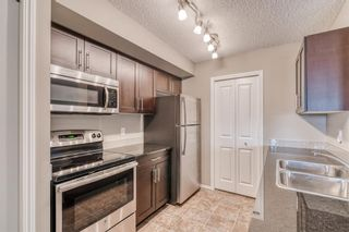 Photo 3: 6205 403 Mackenzie Way SW: Airdrie Apartment for sale : MLS®# A1145558