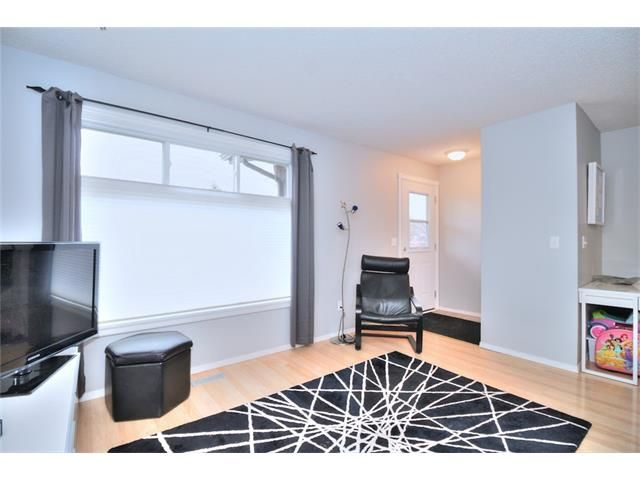 Photo 5: Photos: 108 SHAWGLEN Road SW in Calgary: Shawnessy House for sale : MLS®# C4038520