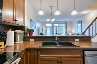 Photo 12: 2 172 Rockyledge View NW in Calgary: Rocky Ridge Row/Townhouse for sale : MLS®# A1152738