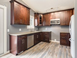 Photo 7: 15415 Deer Side Road SE in Calgary: Deer Run Detached for sale : MLS®# A1060815
