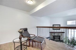Photo 10: 24 GLAMIS Gardens SW in Calgary: Glamorgan Row/Townhouse for sale : MLS®# A1077235