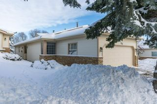 Photo 1: 113 Shawnee Rise SW in Calgary: Shawnee Slopes Semi Detached for sale : MLS®# A1068673