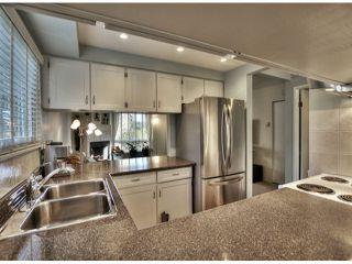 """Photo 2: 7712 119A ST in Delta: Scottsdale Townhouse for sale in """"WALDEN GLEN"""" (N. Delta)  : MLS®# F1304650"""