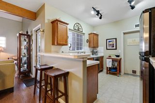 Photo 5: 101 1997 Sirocco Drive SW in Calgary: Signal Hill Row/Townhouse for sale : MLS®# A1142333