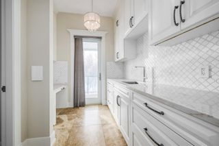 Photo 11: 159 Posthill Drive SW in Calgary: Springbank Hill Detached for sale : MLS®# A1067466