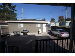 Photo 17: 1591 E 59TH Avenue in Vancouver: Fraserview VE House for sale (Vancouver East)  : MLS®# V1031963