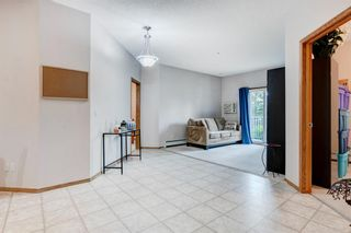 Photo 5: 111 72 Quigley Drive: Cochrane Apartment for sale : MLS®# A1137797