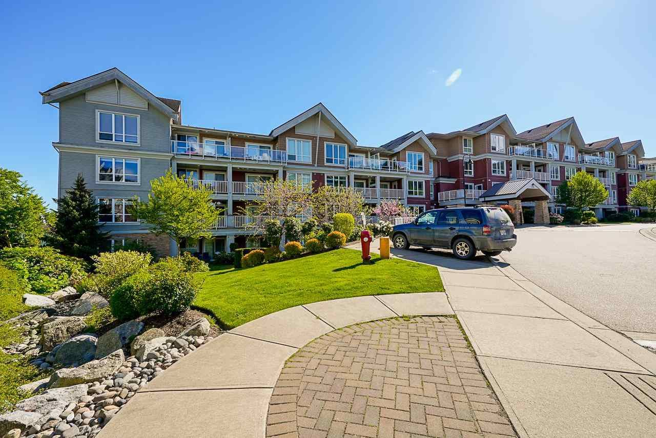 """Main Photo: 401 6440 194 Street in Surrey: Clayton Condo for sale in """"WATERSTONE"""" (Cloverdale)  : MLS®# R2578051"""