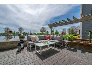 """Photo 1: 102 4500 WESTWATER Drive in Richmond: Steveston South Condo for sale in """"COPPER SKY WEST"""" : MLS®# R2266032"""