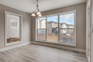 Photo 4: 11 Everhollow Crescent SW in Calgary: Evergreen Detached for sale : MLS®# A1062355