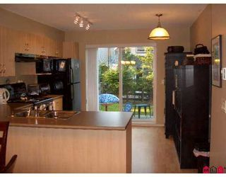 """Photo 4: 77 15871 85TH Avenue in Surrey: Fleetwood Tynehead Townhouse for sale in """"Huckleberry"""" : MLS®# F2716364"""