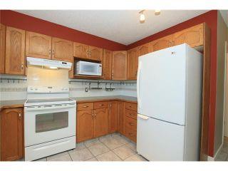Photo 14: 74 WEST TERRACE Road: Cochrane House for sale : MLS®# C4073559