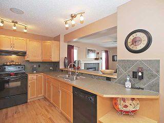 Photo 6: 215 EVANSMEADE Common NW in CALGARY: Evanston Residential Detached Single Family for sale (Calgary)  : MLS®# C3554282