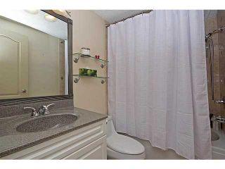 Photo 14: 116 LAKE PLACID Road SE in Calgary: Lk Bonavista Estates Residential Detached Single Family for sale : MLS®# C3654638