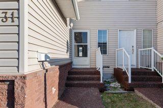 Photo 5: 31 309 3 Avenue: Irricana Row/Townhouse for sale : MLS®# A1150050