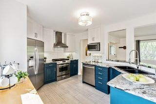 Photo 9: 143 Capri Avenue NW in Calgary: Charleswood Detached for sale : MLS®# A1143044