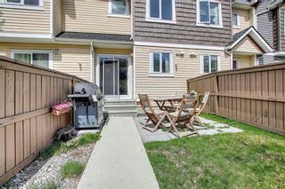 Photo 11: 49 Aspen Hills Drive in Calgary: Aspen Woods Row/Townhouse for sale : MLS®# A1108255