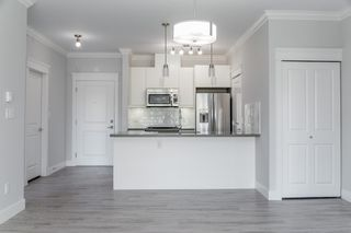 """Photo 4: 104 2229 ATKINS Avenue in Port Coquitlam: Central Pt Coquitlam Condo for sale in """"Downtown Point"""" : MLS®# R2437113"""