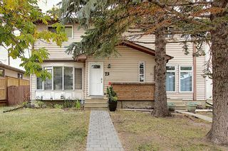 Photo 1: 73 CEDARDALE Crescent SW in Calgary: Cedarbrae Semi Detached for sale : MLS®# A1037237