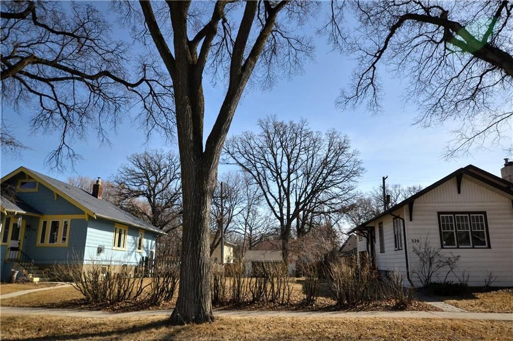 Main Photo: 318 Beaverbrook Street in Winnipeg: River Heights North Residential for sale (1C)  : MLS®# 202106213